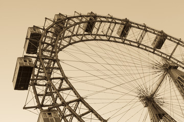 Old ferris wheel in Prater park in Vienna, sepia