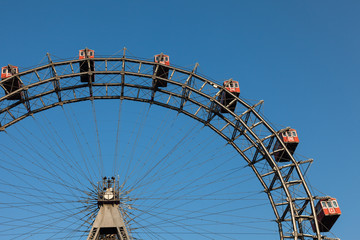 Ferris wheel with red cabines in Prater park, Vienna
