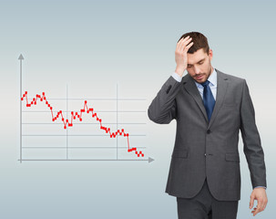 businessman over forex graph going down