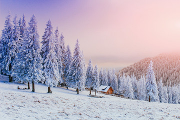 sunset in the winter mountains and fantastic chalet