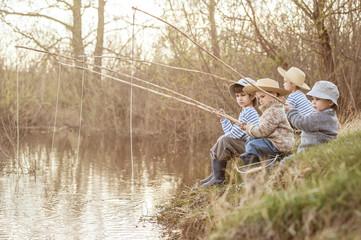 Boys fishing on the lake