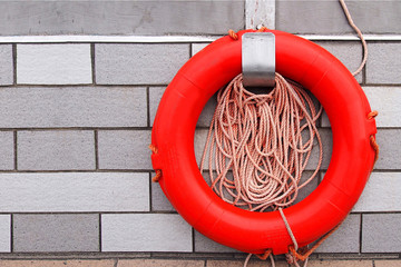 A lifebuoy on concrete background.