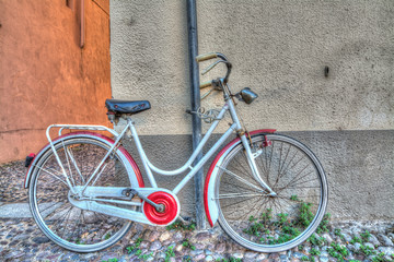red and white bike against the wall
