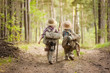 Leinwanddruck Bild - Boys on a forest road with backpacks