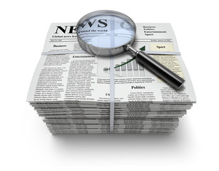Newspapers with magnifier