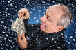 man with a bundle of dollars in snowfall