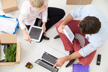 Overhead View Of Businesspeople Working At Laptop