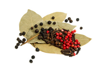 Bay leaves, carnation and pepper isolated on white background
