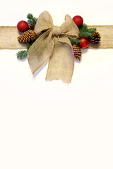 Burlap Christmas Bow, and Ornaments with Pinecones Isolated on W