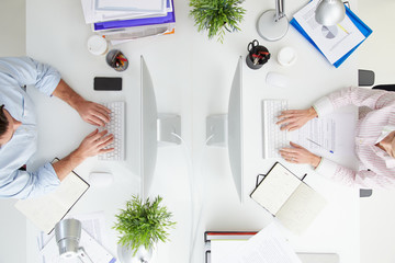 Overhead View Of Businesspeople Working At Office Computer