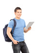 Vertical shot of a male student holding a tablet