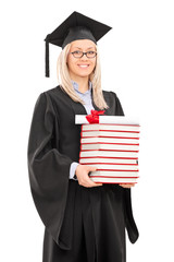 Female graduate student holding a stack of books