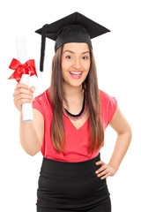 Excited female student holding a diploma