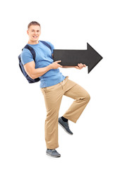 Male student holding a big black arrow