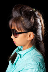 beautiful tanned girl in sunglasses and fashionable hairstyle