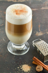 Cinnamon latte. Coffee on a dark background