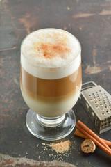 Cinnamon latte. Coffee on a dark background