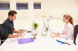 canvas print picture - Businesspeople Working At Desks In Modern Office