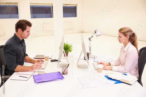 canvas print picture Businesspeople Working At Desks In Modern Office