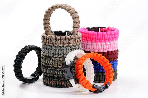 Staande foto Alpinisme Parachute cord bracelets of different colors