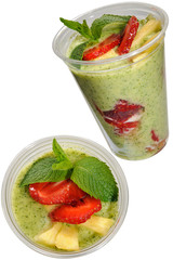 Fast food mousse with mint and strawberries in a plastic cup