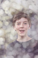 portrait of a lucky teenage boy, with bokeh around