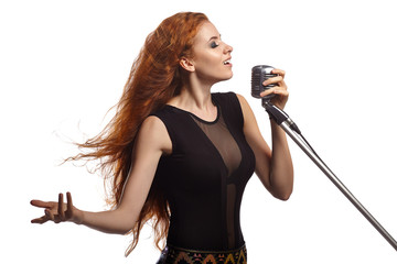 Singing woman with retro microphone.