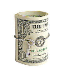 Roll of dollars with key isolated on white background