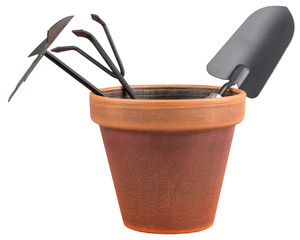 Garden tools in a orange vase