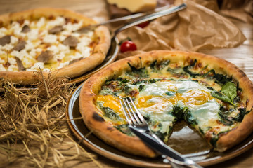 Margarita pizza with arugula and egg