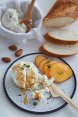 Ricotta cheese appetiser with honey and fruit