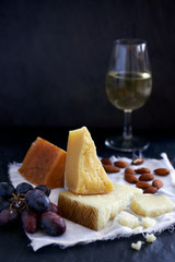 Cheese and wine tasting, cheddar gruyere goats with nuts
