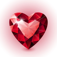 Red shining ruby heart shape on white background