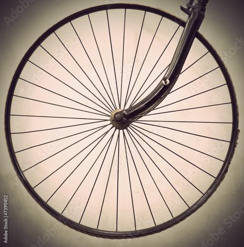 Foto op Plexiglas Fiets Wheel of ancient bicycle