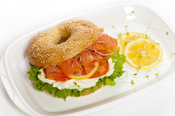 Cream cheese and smoked salmon bagel. Selective focus.
