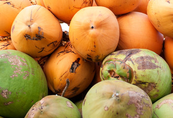 Bunch of yellow and green coconut