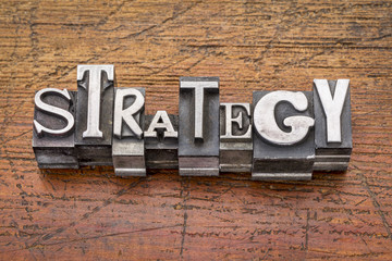 strategy word in metal type