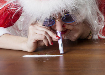 Rich Santa Claus sniffing sugar
