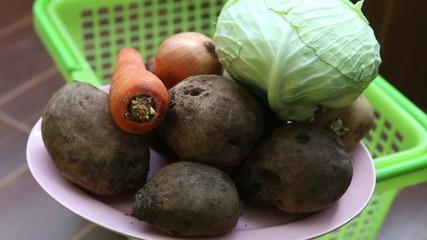 vegetables for borscht lie on a plate - beet, potato, onion
