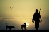 Fototapety hunter at sunset