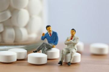 錠剤と男たち