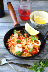 Tasty paella mussels and squid with black tiger prawns