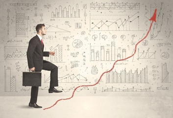 Business man climbing on red graph arrow concept