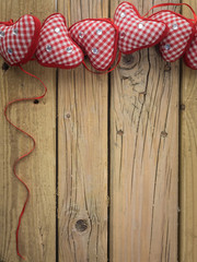 red check hearts on rustic wooden background