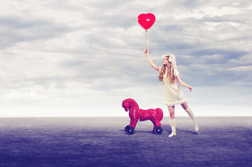 Girl doll with balloon and toy horse walks outdoors.