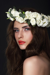 Sensuality. Young Brunette wearing Wreath of Roses