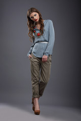 Studio Shot of Trendy Fashion Model in Pants and Blouse