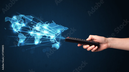 canvas print picture Hand with remote control, social media concept