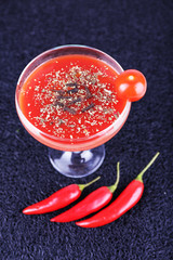 Tomato juice in goblet, chilly pepper and fresh tomatoes