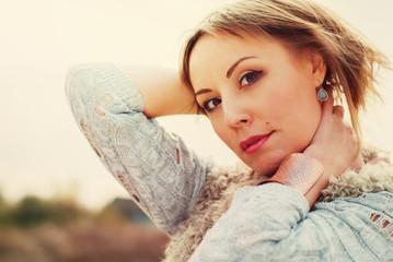 Portrait of Beautiful Woman. embraces the neck